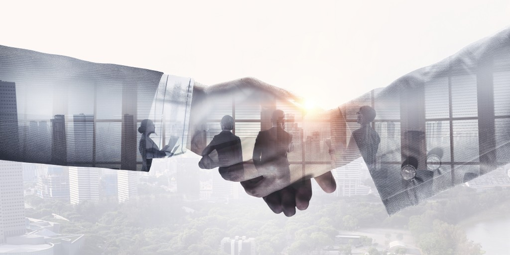 Closeup of business handshake against city background